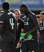 Brendan Rodgers manager of Liverpool laughs with Christain Benteke at the end of a preseason friendly at County Ground on August 2 2015 in Swindon...