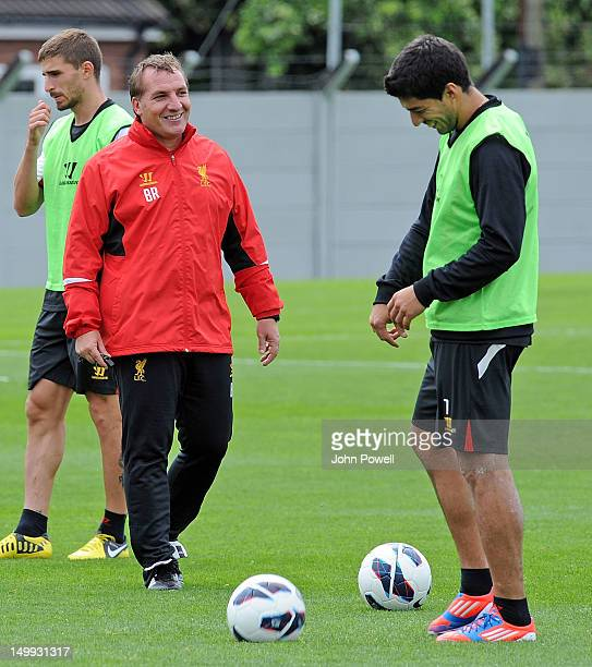 Brendan Rodgers Manager of Liverpool laughs with Luis Suarez during a training session at Melwood Training Ground on August 7 2012 in Liverpool...