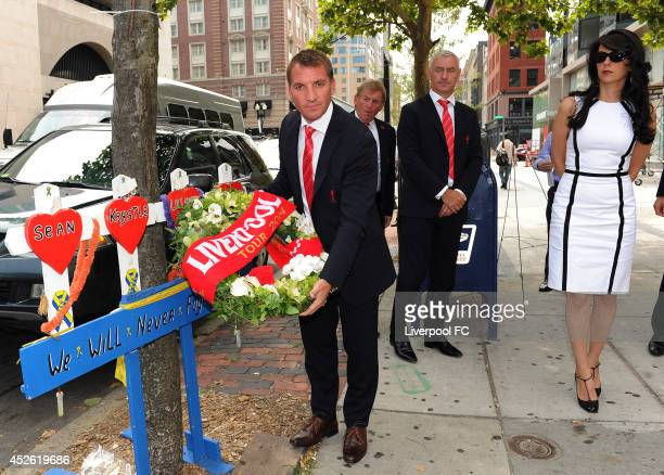 Brendan Rodgers manager of Liverpool lays a wreath on Boylston Street in memory of the lives lost in the Boston Marathon bombings with Kenny Dalglish...