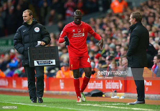 Brendan Rodgers manager of Liverpool looks on as Mario Balotelli of Liverpool is substituted during the Barclays Premier League match between...
