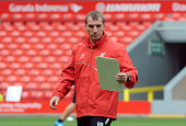 Brendan Rodgers manager of Liverpool looks on during a training session at Anfield on August 8 2014 in Liverpool England