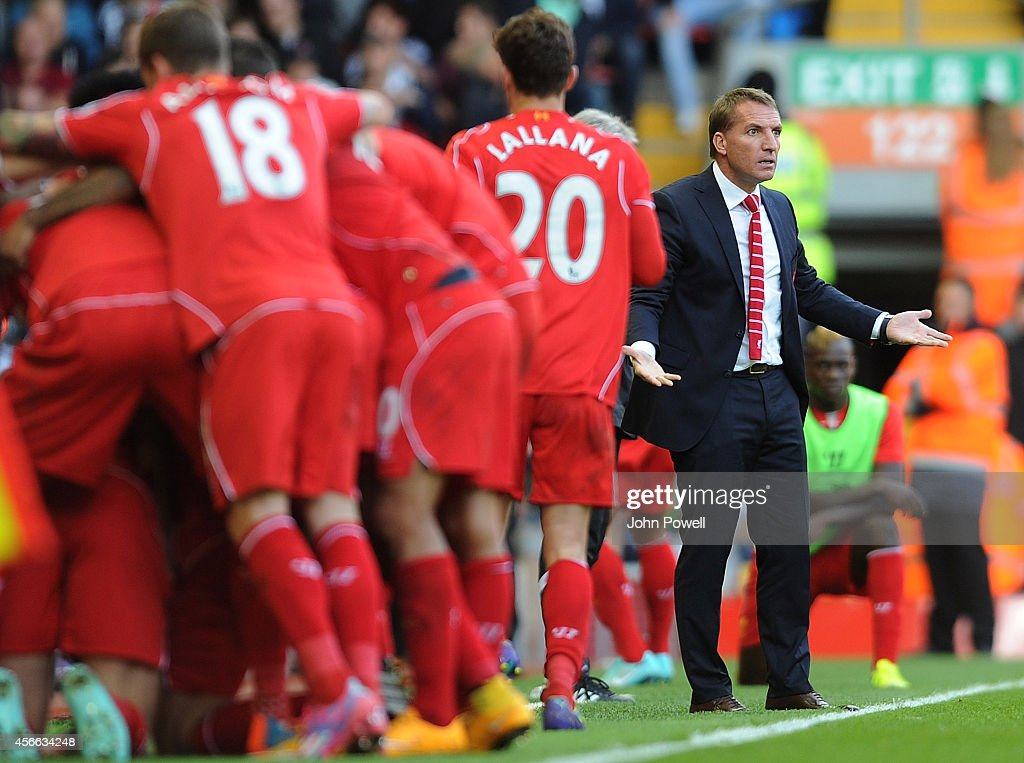 Brendan Rodgers manager of Liverpool reacts as the team celebrate the second goal during the Barclays Premier League match between Liverpool and West Bromwich Albion at Anfield on October 4, 2014 in Liverpool, England.