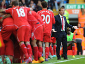 Brendan Rodgers manager of Liverpool reacts as the team celebrate the second goal during the Barclays Premier League match between Liverpool and West...