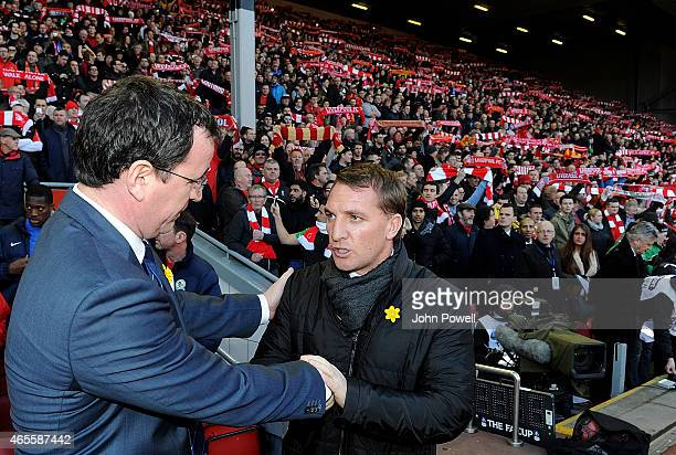 Brendan Rodgers manager of Liverpool shakes hands with Gary Bowyer manager of Blackburn Rovers before the FA Cup Quarter Final match between...