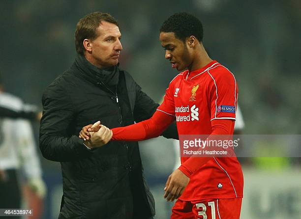 Brendan Rodgers manager of Liverpool shakes hands with Raheem Sterling of Liverpool after defeat in a penalty shoot out during the UEFA Europa League...