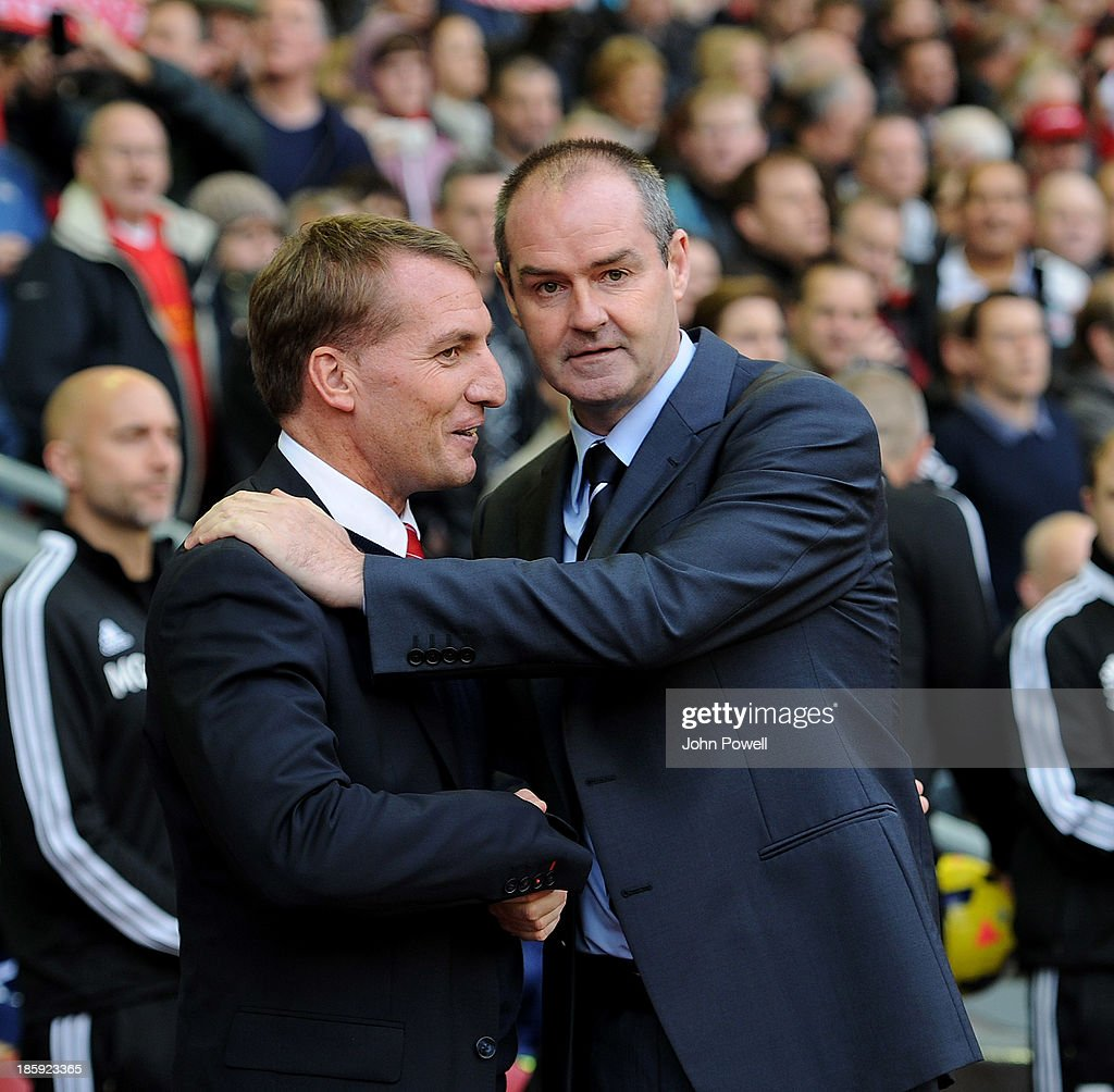 Brendan Rodgers manager of Liverpool (L) shakes hands with Steve Clarke manager of West Browich Albion before the Barclays Premier League match between Liverpool and West Bromwich Albion at Anfield on October 26, 2013 in Liverpool, England.