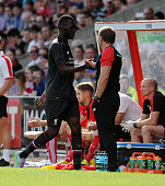 Brendan Rodgers manager of Liverpool shankes hands with Christian Benteke during a preseason friendly at County Ground on August 2 2015 in Swindon...