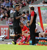 Brendan Rodgers manager of Liverpool shankes hands with Roberto Firmino during a preseason friendly at County Ground on August 2 2015 in Swindon...