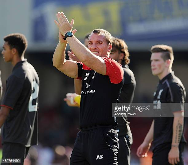 Brendan Rodgers manager of Liverpool shows his appreciation to the fans at the end of a preseason friendly at County Ground on August 2 2015 in...
