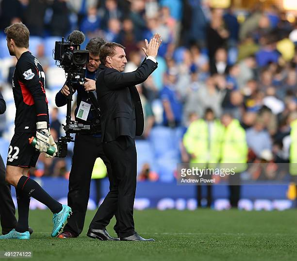 Brendan Rodgers manager of Liverpool shows his appreciation to the fans at the end of the Barclays Premier League match between Everton and Liverpool...