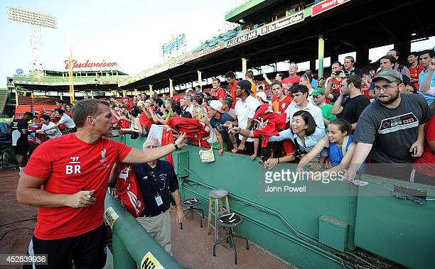 Brendan Rodgers manager of Liverpool signs autographs after a training session at Fenway Park on July 22 2014 in Boston Massachusetts