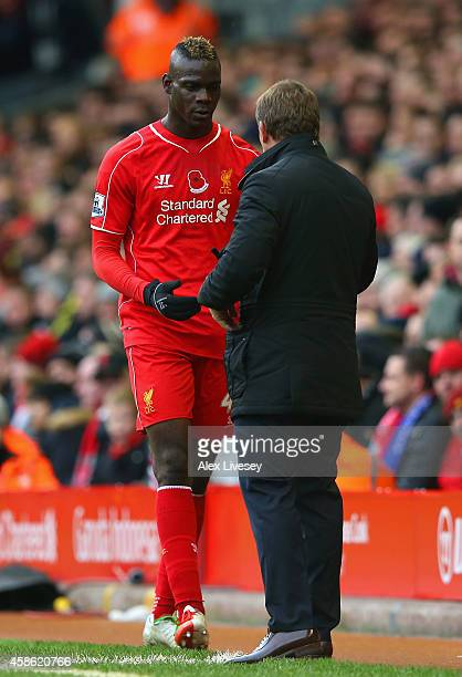 Brendan Rodgers manager of Liverpool speaks to Mario Balotelli of Liverpool is substituted during the Barclays Premier League match between Liverpool...