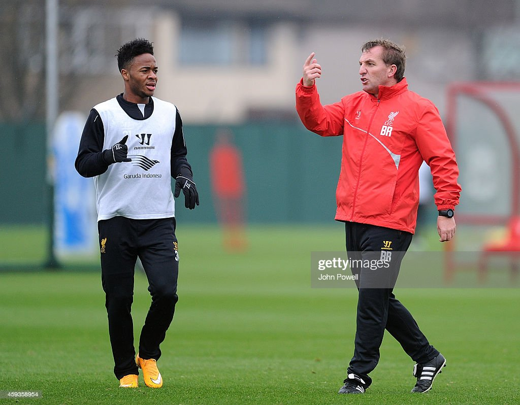 Brendan Rodgers manager of Liverpool talking to Raheem Sterling of Liverpool during a training session at Melwood Training Ground on November 21, 2014 in Liverpool, England.