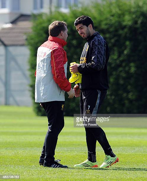 Brendan Rodgers manager of Liverpool talking with Luis Suarez during a training session at Melwood Training Ground on April 10 2014 in Liverpool...
