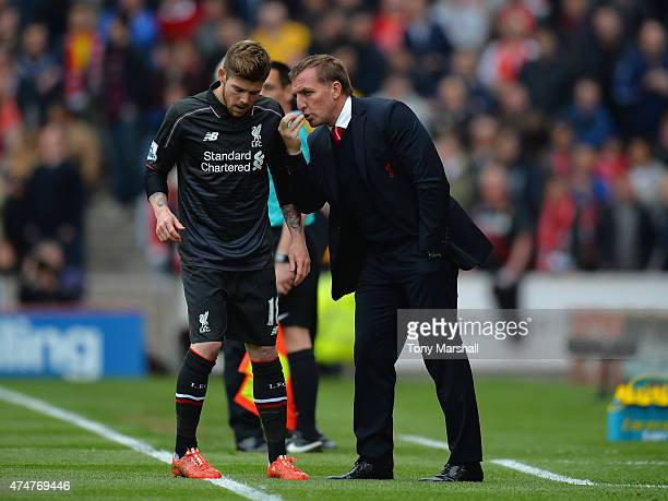 Brendan Rodgers Manager of Liverpool talks to Alberto Moreno of Liverpool on the touch line during the Barclays Premier League match between Stoke...