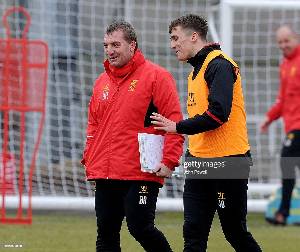 Brendan Rodgers manager of Liverpool talks with Adam Morgan during a training session at Melwood Training Ground on April 11, 2013 in Liverpool, England.
