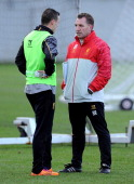 Brendan Rodgers manager of Liverpool talks with Brad Smith during a training session at Melwood Training Ground on January 16 2014 in Liverpool...