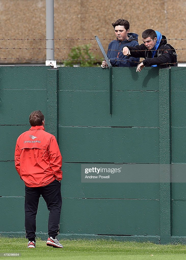 Brendan Rodgers manager of Liverpool talks with fans over the wall in action during a training session at Melwood Training Ground on May 14 2015 in...