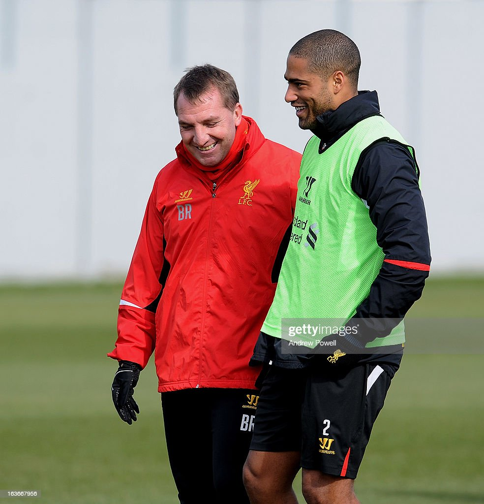 Brendan Rodgers manager of Liverpool talks with Glen Johnson during a training session at Melwood Training Ground on March 14, 2013 in Liverpool, England.
