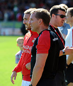 Brendan Rodgers manager of Liverpool talks with his son Anton Rodgers before a preseason friendly at County Ground on August 2 2015 in Swindon England