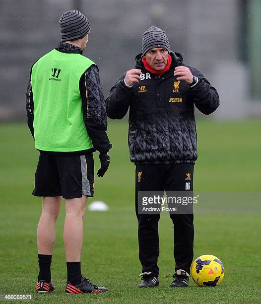 Brendan Rodgers manager of Liverpool talks with Jon Flanagan during a training session at Melwood Training Ground on January 31 2014 in Liverpool...