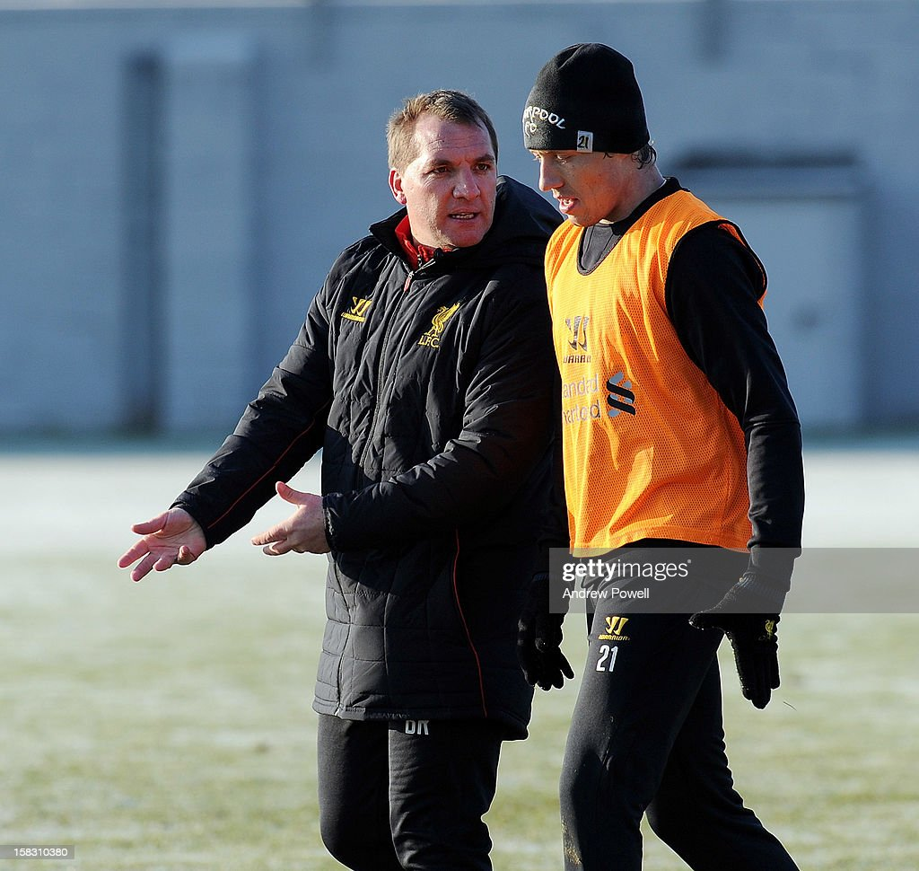 <a gi-track='captionPersonalityLinkClicked' href=/galleries/search?phrase=Brendan+Rodgers+-+Soccer+Manager&family=editorial&specificpeople=5446684 ng-click='$event.stopPropagation()'>Brendan Rodgers</a> manager of Liverpool talks with <a gi-track='captionPersonalityLinkClicked' href=/galleries/search?phrase=Lucas+Leiva+-+Defensive+Midfielder+-+Born+1987&family=editorial&specificpeople=4114250 ng-click='$event.stopPropagation()'>Lucas Leiva</a> during a training session at Melwood Training Ground on December 13, 2012 in Liverpool, England.