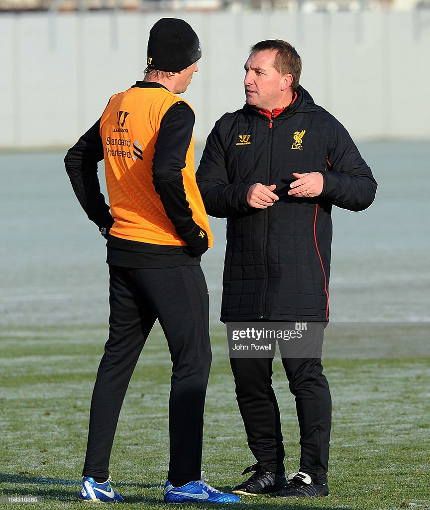 Brendan Rodgers manager of Liverpool talks with Lucas Leiva during a training session at Melwood Training Ground on December 13, 2012 in Liverpool, England.