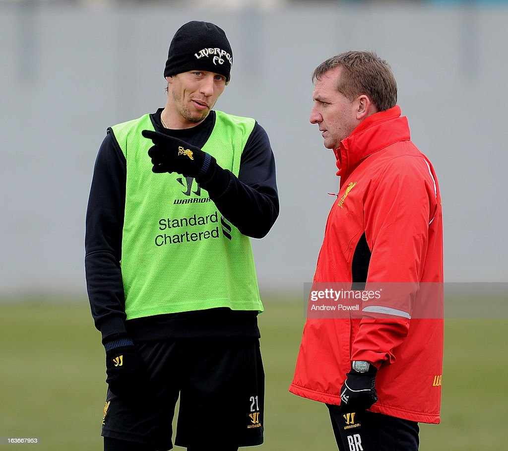 <a gi-track='captionPersonalityLinkClicked' href=/galleries/search?phrase=Brendan+Rodgers+-+Soccer+Manager&family=editorial&specificpeople=5446684 ng-click='$event.stopPropagation()'>Brendan Rodgers</a> manager of Liverpool talks with <a gi-track='captionPersonalityLinkClicked' href=/galleries/search?phrase=Lucas+Leiva+-+Defensive+Midfielder+-+Born+1987&family=editorial&specificpeople=4114250 ng-click='$event.stopPropagation()'>Lucas Leiva</a> during a training session at Melwood Training Ground on March 14, 2013 in Liverpool, England.