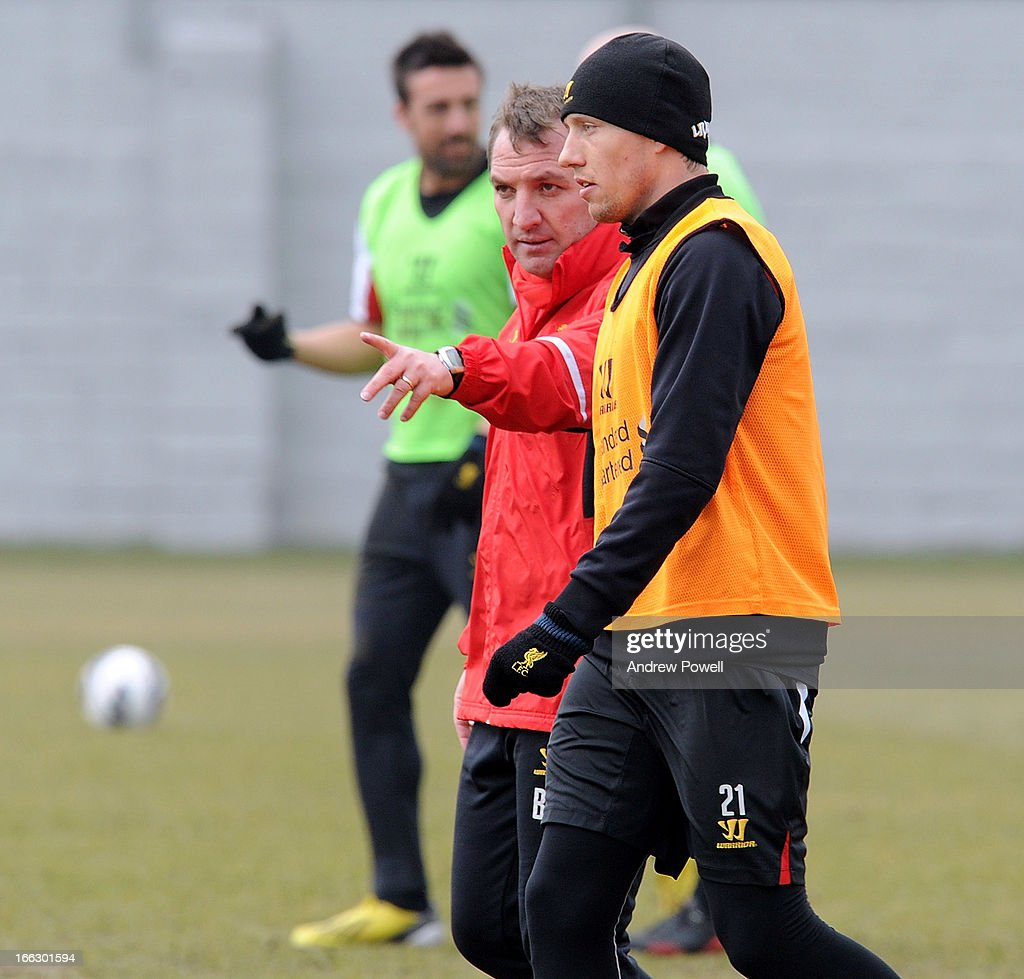Brendan Rodgers manager of Liverpool talks with Lucas Leiva during a training session at Melwood Training Ground on April 11, 2013 in Liverpool, England.
