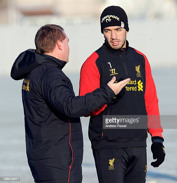 Brendan Rodgers manager of Liverpool talks with Luis Suarez during a training session at Melwood Training Ground on December 13 2012 in Liverpool...