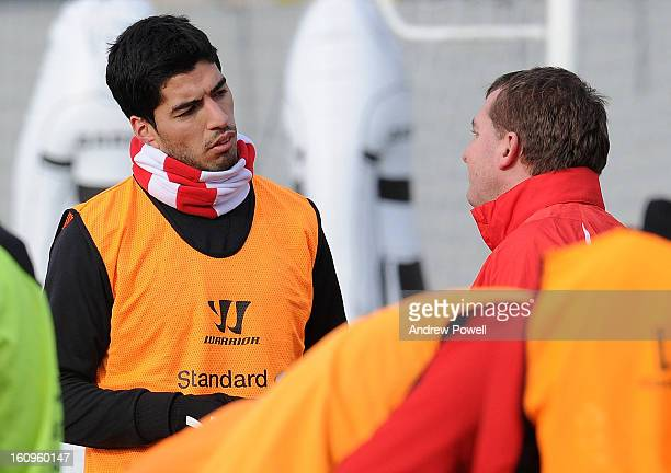 Brendan Rodgers manager of Liverpool talks with Luis Suarez during a training session at Melwood Training Ground on February 8 2013 in Liverpool...