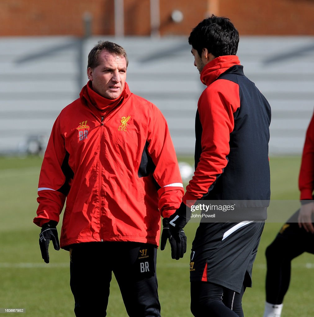 Brendan Rodgers manager of Liverpool talks with Luis Suarez during a training session at Melwood Training Ground on March 14, 2013 in Liverpool, England.