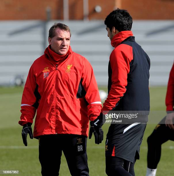 Brendan Rodgers manager of Liverpool talks with Luis Suarez during a training session at Melwood Training Ground on March 14 2013 in Liverpool England