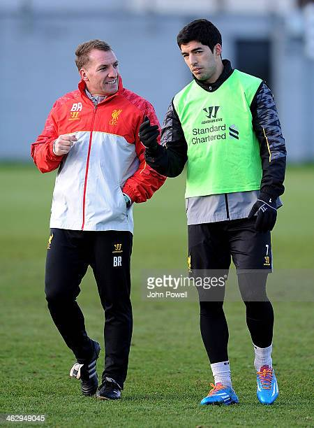 Brendan Rodgers manager of Liverpool talks with Luis Suarez during a training session at Melwood Training Ground on January 16 2014 in Liverpool...