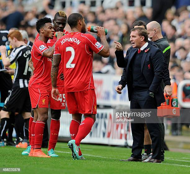 Brendan Rodgers manager of Liverpool talks with Mario Balotelli Raheem Sterling and Glen Johnson during the Barclays Premier League match between...