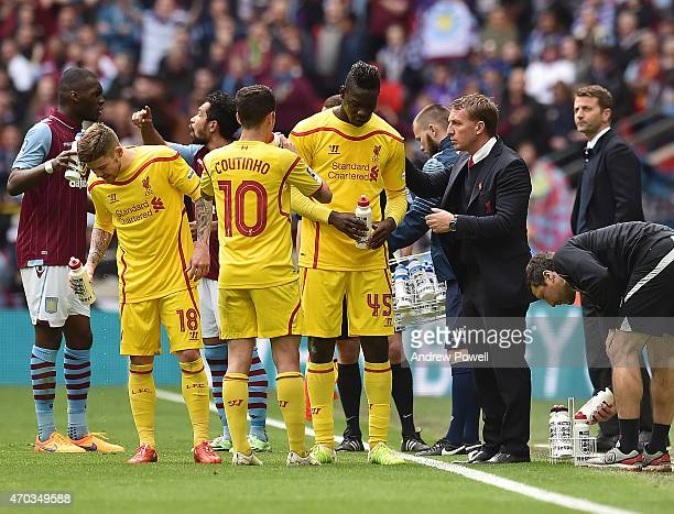 Brendan Rodgers manager of Liverpool talks with Mario Balotelli and Philippe Coutinho during the FA Cup SemiFinal match between Aston Villa and...