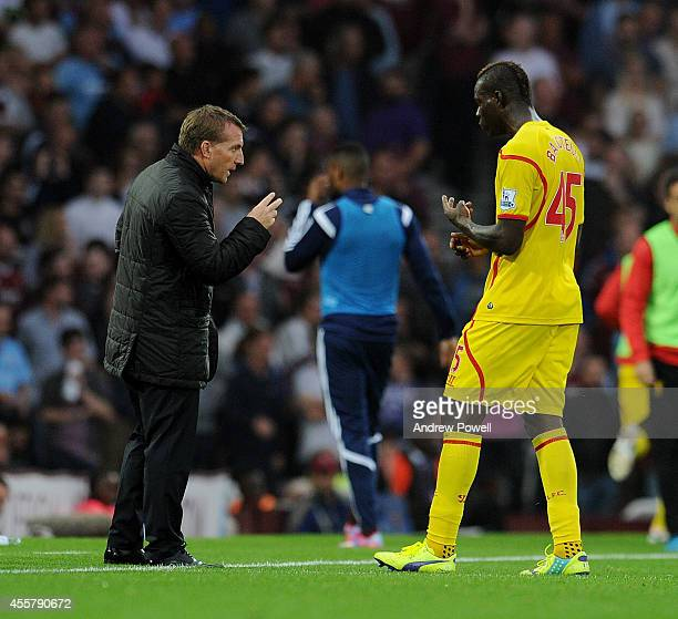 Brendan Rodgers manager of Liverpool talks with Mario Balotelli during the Barclays Premier League match between West Ham United and Liverpool at...