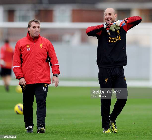 Brendan Rodgers manager of Liverpool talks with Pepe Reina during a training session at Melwood Training Ground on November 9 2012 in Liverpool...