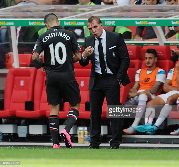 Brendan Rodgers manager of Liverpool talks with Philippe Coutinho of Liverpool during the Barclays Premier League match between Stoke City and...