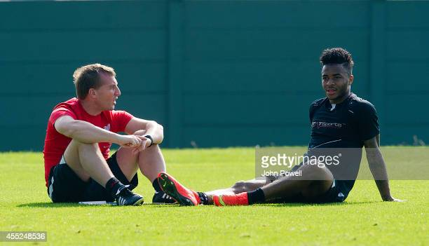 Brendan Rodgers manager of Liverpool talks with Raheem Sterling during a training session at Melwood Training Ground on September 11 2014 in...