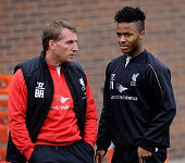 Brendan Rodgers manager of Liverpool talks with Raheem Sterling during a training session at Melwood Training Ground on September 25 2014 in...