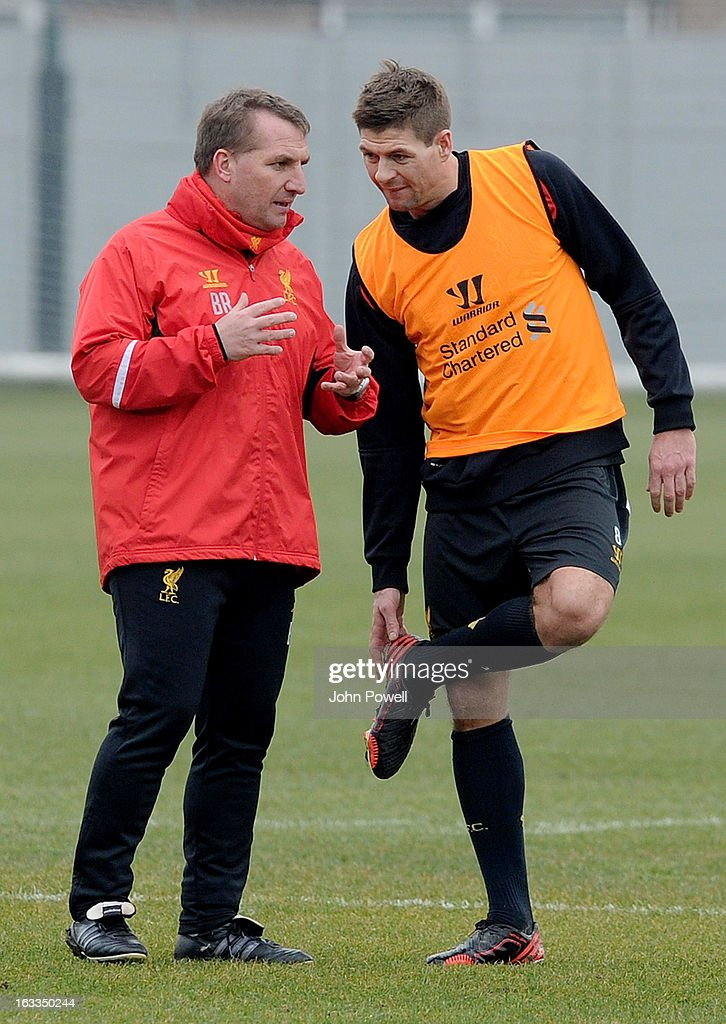 Brendan Rodgers manager of Liverpool talks with Steven Gerrard during a training session at Melwood Training Ground on March 8, 2013 in Liverpool, England.
