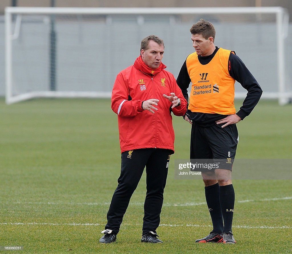 <a gi-track='captionPersonalityLinkClicked' href=/galleries/search?phrase=Brendan+Rodgers+-+Soccer+Manager&family=editorial&specificpeople=5446684 ng-click='$event.stopPropagation()'>Brendan Rodgers</a> manager of Liverpool talks with <a gi-track='captionPersonalityLinkClicked' href=/galleries/search?phrase=Steven+Gerrard&family=editorial&specificpeople=202052 ng-click='$event.stopPropagation()'>Steven Gerrard</a> during a training session at Melwood Training Ground on March 8, 2013 in Liverpool, England.