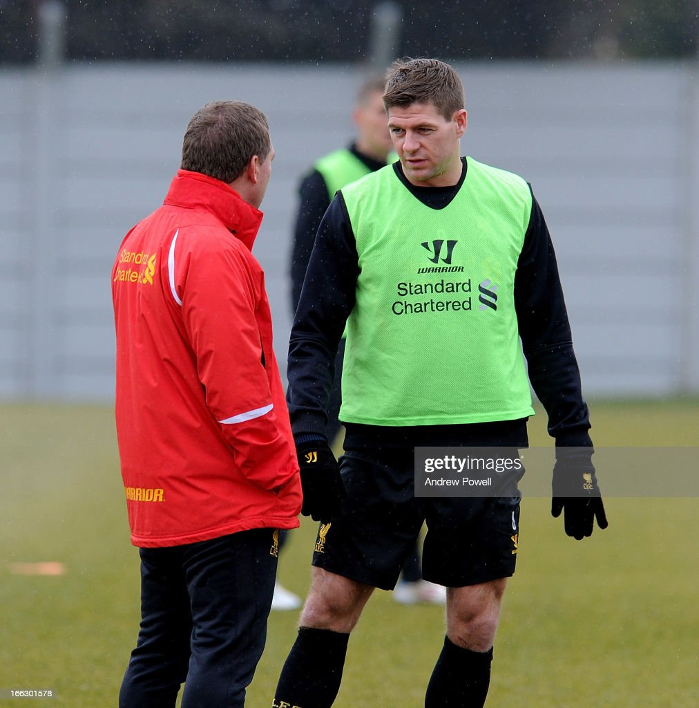 Brendan Rodgers manager of Liverpool talks with Steven Gerrard during a training session at Melwood Training Ground on April 11, 2013 in Liverpool, England.
