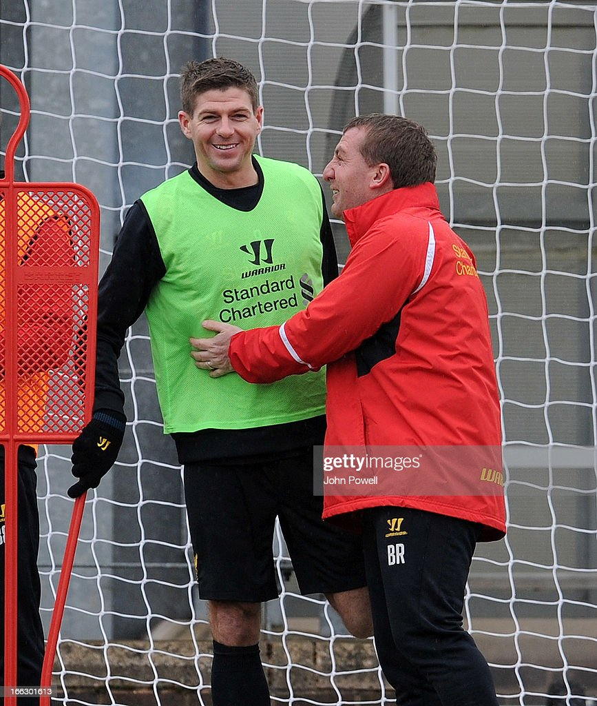 <a gi-track='captionPersonalityLinkClicked' href=/galleries/search?phrase=Brendan+Rodgers+-+Soccer+Manager&family=editorial&specificpeople=5446684 ng-click='$event.stopPropagation()'>Brendan Rodgers</a> manager of Liverpool talks with <a gi-track='captionPersonalityLinkClicked' href=/galleries/search?phrase=Steven+Gerrard&family=editorial&specificpeople=202052 ng-click='$event.stopPropagation()'>Steven Gerrard</a> during a training session at Melwood Training Ground on April 11, 2013 in Liverpool, England.