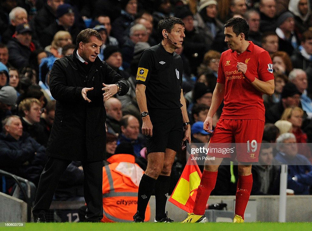 Brendan Rodgers manager of Liverpool talks with Stewart Downing during the Barclays Premier League match between Manchester City and Liverpool at Etihad Stadium on February 3, 2013 in Manchester, England.