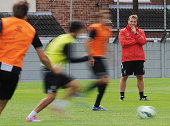Brendan Rodgers manager of Liverpool watches his players in action during a training session at Melwood Training Ground on August 23 2014 in...