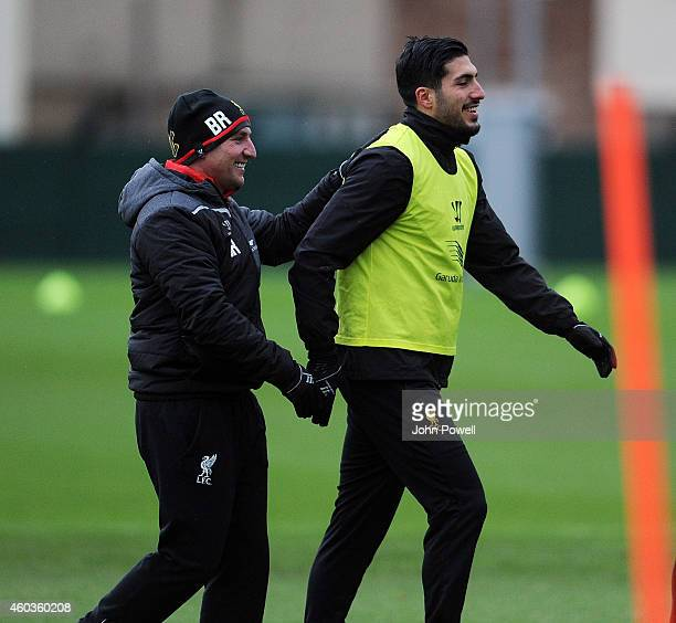 Brendan Rodgers manager of Liverpool with Emre Can during a training session at Melwood Training Ground on December 12 2014 in Liverpool England