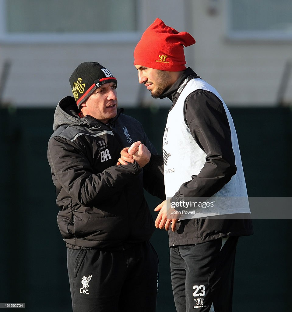 Brendan Rodgers manager of Liverpool with Emre Can of Liverpool during a training session at Melwood Training Ground on January 15 2015 in Liverpool...