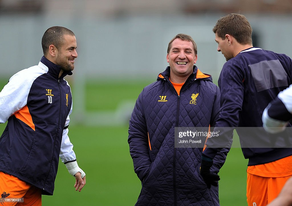 OUT. <a gi-track='captionPersonalityLinkClicked' href=/galleries/search?phrase=Brendan+Rodgers+-+Soccer+Manager&family=editorial&specificpeople=5446684 ng-click='$event.stopPropagation()'>Brendan Rodgers</a> manager of Liverpool (Center) with Joe Cole (Left) and Steven Gerrard captain of Liverpool at Melwood Training Ground on November 21, 2012 in Liverpool, England.